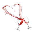 Two glasses of red wine with heart splash Royalty Free Stock Photo