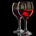 Two glasses of red wine isolated over black background Stock Photo