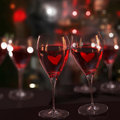 Two glasses of red wine, with love. Royalty Free Stock Photos