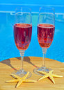 Two glasses of sparkling red wine and  starfish Royalty Free Stock Photo
