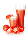 Two glasses of tomato juice with tomatoes isolated on white background Stock Photography
