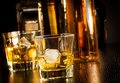 Two glasses of whiskey in front of bottles Royalty Free Stock Photo