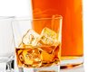Two glasses of whiskey near bottle on white background with reflection time relax whisky Royalty Free Stock Images