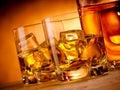 Two glasses whiskey rocks bottle Stock Photos