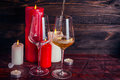 Two glasses of  wine and candles Royalty Free Stock Photo