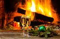 Two glasses of wine and Christmas New Year decoration, fireplace Royalty Free Stock Photo