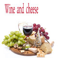 Two glasses of wine grapes and cheese assortment on a wooden board isolated on white Stock Image