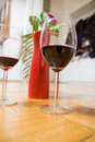 Two glasses of wine and red rose in a vase Royalty Free Stock Photography