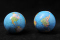 Two globes on a dark background time concept Royalty Free Stock Images