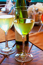 Two goblets with white wine on restaurant table Royalty Free Stock Photography