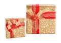 Two gold shiny paper wrap red flower bow gift box isolated Royalty Free Stock Photo