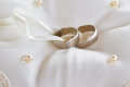 Two gold wedding rings on a pillow Royalty Free Stock Photo