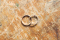 Two gold wedding rings on vintage backgrounds Royalty Free Stock Photo