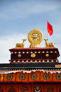 Two golden deer flanking a dharma wheel on jokhang the rooftop statues of the the also called the qokang monastery jokang Stock Photography