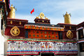 Two golden deer flanking a dharma wheel on jokhang the rooftop statues of the the also called the qokang monastery jokang Royalty Free Stock Photo