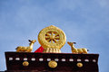 Two golden deer flanking a dharma wheel on jokhang the rooftop statues of the the also called the qokang monastery jokang Royalty Free Stock Image