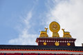 Two golden deer flanking a dharma wheel on ramoche temple the rooftop statues of the xiaozhao si is buddhist Royalty Free Stock Photo