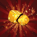 Two golden dice on shiny background Royalty Free Stock Images