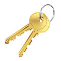 Two golden door keys pair of isolated on white background Stock Photo