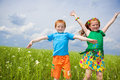 Two golden-haired children playin the field Stock Images