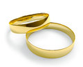 Two golden wedding rings on white background Stock Images