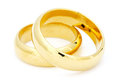 Two golden wedding on white rings a background Stock Image