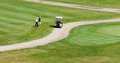 Two golfers and a golf cart Royalty Free Stock Photography