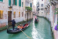 Two gondolas taking tourists for a ride in venice italy Royalty Free Stock Images