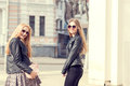 Two gorgeous girl friends having fun outside in the city Royalty Free Stock Photo