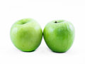 Two green apples on a white background - front view Royalty Free Stock Photo