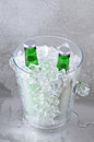 Two Green Beers in Crystal Ice Bucket Royalty Free Stock Photography