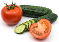 Two green cucumber and tomatoes Royalty Free Stock Photo