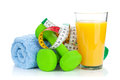 Two green dumbells tape measure and orange juice fitness and h health isolated on white background Stock Photos