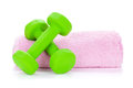 Two green dumbells and towel isolated on white background Stock Photography