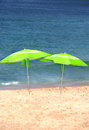 Two green sun umbrellas on the beach Royalty Free Stock Photo