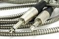 Two guitar plug-in jacks and cable Royalty Free Stock Photo