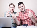 Two guys with funny gestures Royalty Free Stock Photo