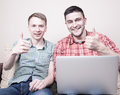 Two guys with gadgets Royalty Free Stock Photo