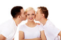 Two guys kissing friend woman cheeks women Royalty Free Stock Photo