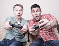 Two guys playing Royalty Free Stock Photo