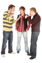 Two guys tell the third that mobile usage is cool Royalty Free Stock Photo