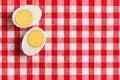 Two halves boiled egg checkered tablecloth Stock Photos