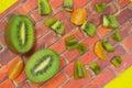 Two halves of kiwi the berries. Slices of tangerine Royalty Free Stock Photo