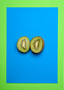 Two halves of kiwi on a blue background Stock Images