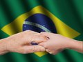 Two hands and brazilian flag old young Stock Photo