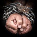 Two hands chained with an iron chain and a padlock Royalty Free Stock Photo