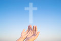 Two hands and cross of christ and believers toward religion Stock Images