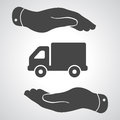 Two hands with flat truck pictogram Royalty Free Stock Photo