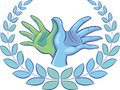 Two hands form a dove symbol circled with a laurel wreath Royalty Free Stock Photo