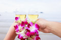Two hands, glasses of champagne and a bouquet of orchids. Stock Photo